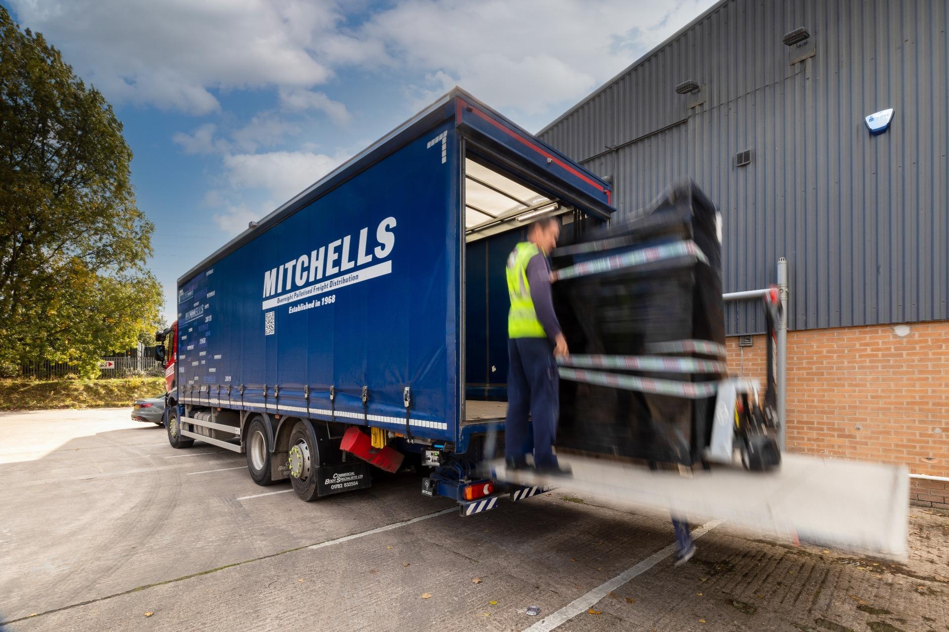 Mitchells driver delivering pallets