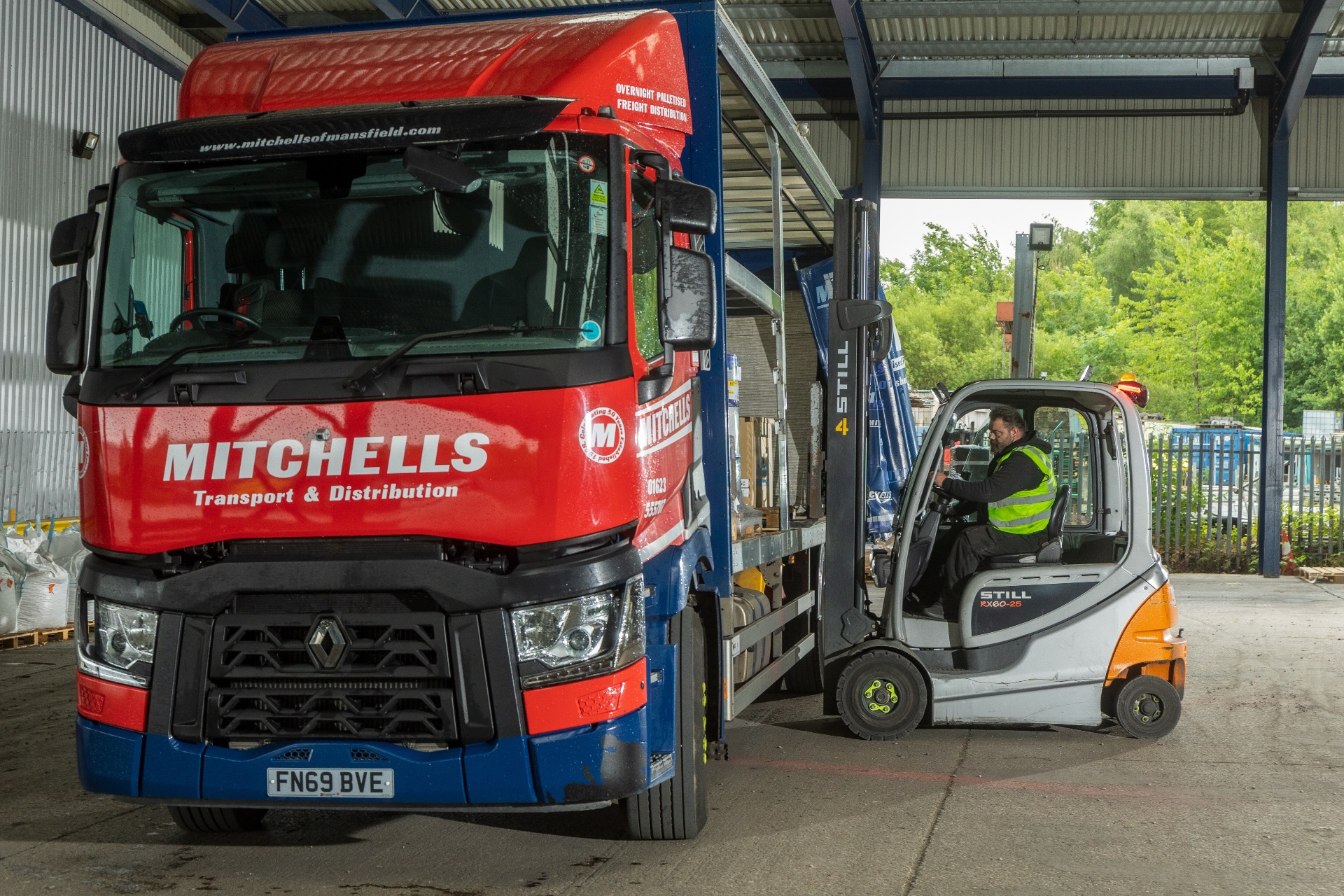 Mitchells lorry being loaded with pallets for delivery