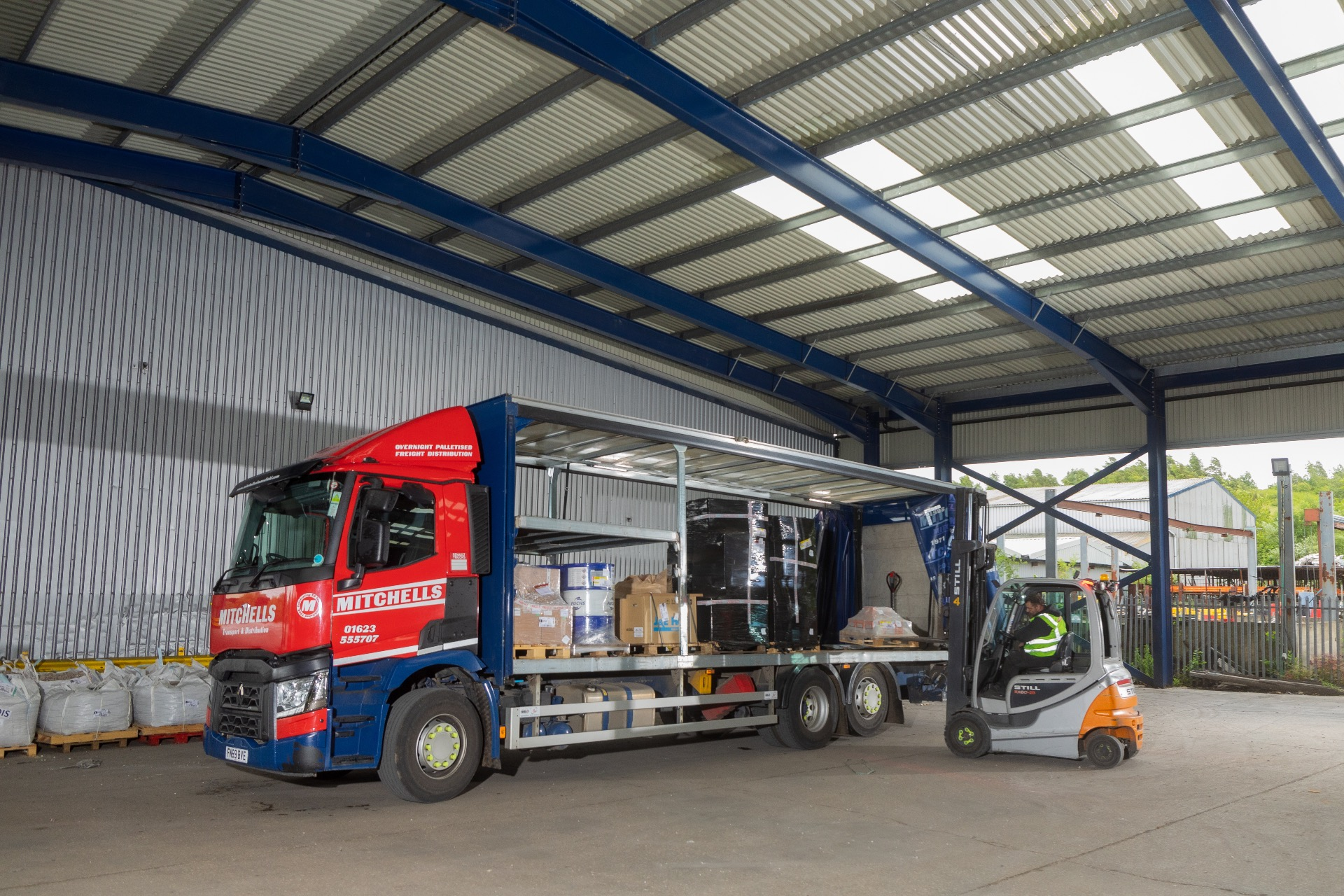 Mitchells lorry being loaded with pallets. A range of vacancies available.