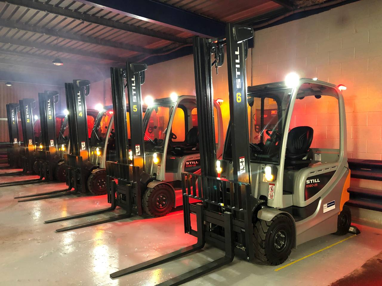 Fork lift trucks in a row in the garage